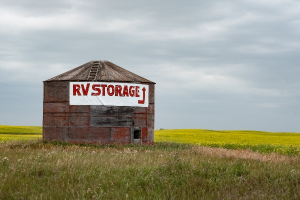 A roadside container has a sign that reads RV storage on it.